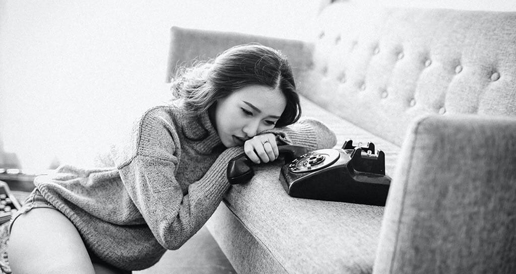 female waiting on call
